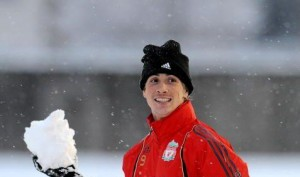 Torres gives up the football for a snowball