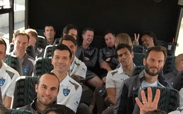 Robbie Fowler looks like the school bully as he & Macca seize back row on star-studded legends bus!