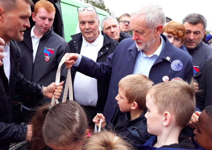 Corbyn donates to foodbank, lays wreath & wears Liverpool scarf