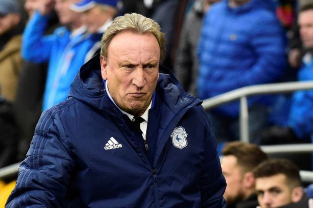 Warnock offers frank view on Liverpool's spending habits; hopes to avoid 'a battering'
