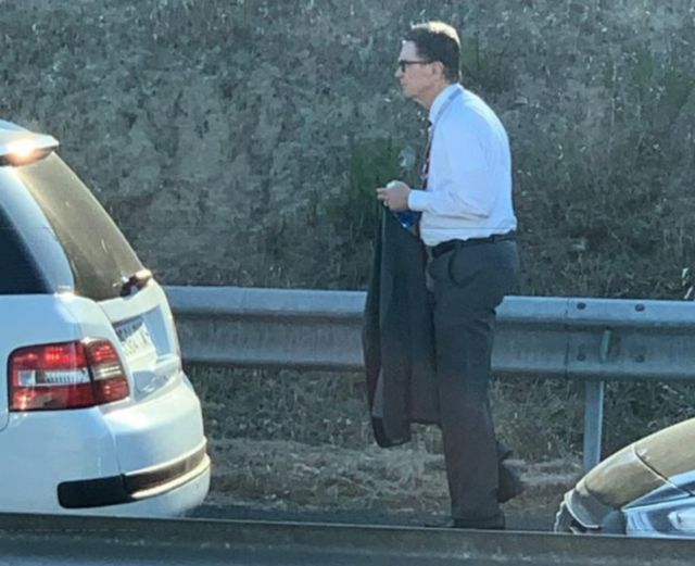 (Photo): John W Henry caught walking to CL final after getting stuck in traffic