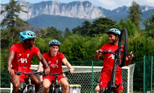 (Image) Elliott can't help but laugh as Brewster wheelies on LFC bike ride