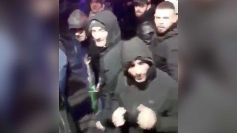 (Video) Hundreds of weapon-yielding Napoli fans march through Liverpool