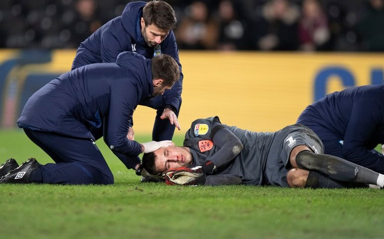 On-loan LFC goalkeeper Kamil Grabara in hospital after being KO'd while playing for Huddersfield