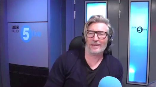 (Video) Greatest radio phone-in ever: Robbie Savage schools moronic Man. City fan who thinks Liverpool are rubbish
