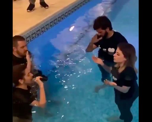 (Video) Alisson baptises Fred's wife in his swimming pool