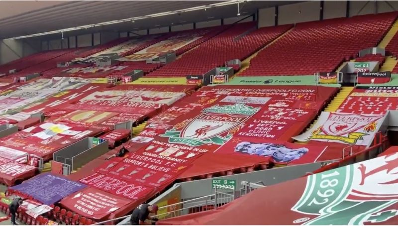 (Video) The Kop has been decorated with classic LFC banners for tonight… and it's great