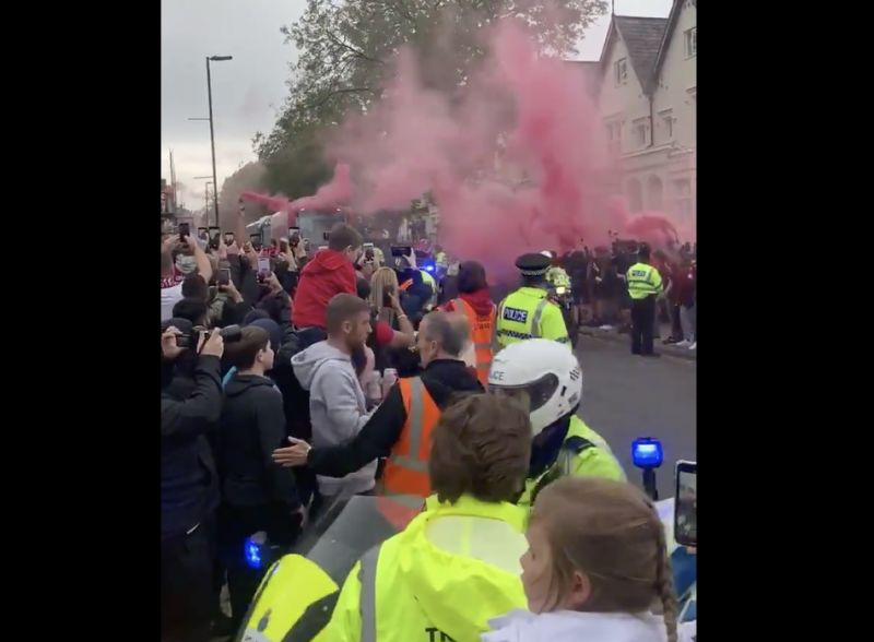 (Video) Liverpool fans – probably too many – gather to welcome the team bus