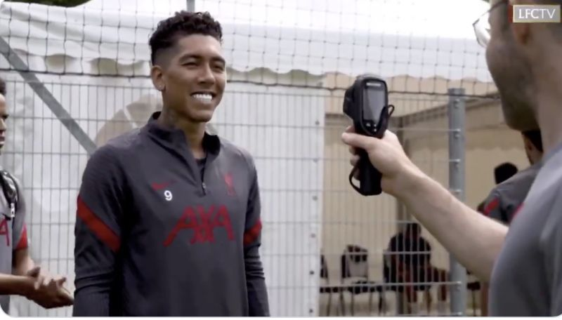 (Video) Hilarious: Firmino thinks thermometer is camera and offers huge, white-toothed smile