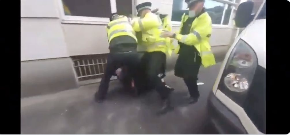 Video shows Old Trafford protestor being punched by police behind a van