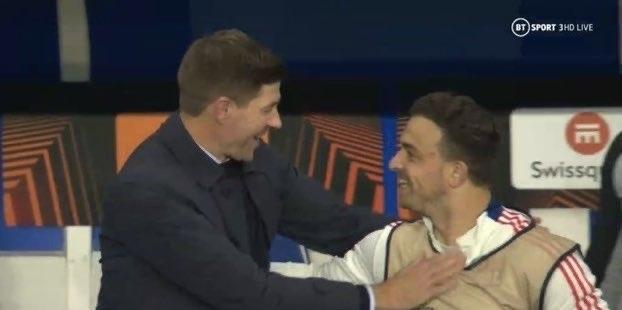(Photo) Steven Gerrard spotted embracing former Liverpool star Xherdan Shaqiri during Europa League clash